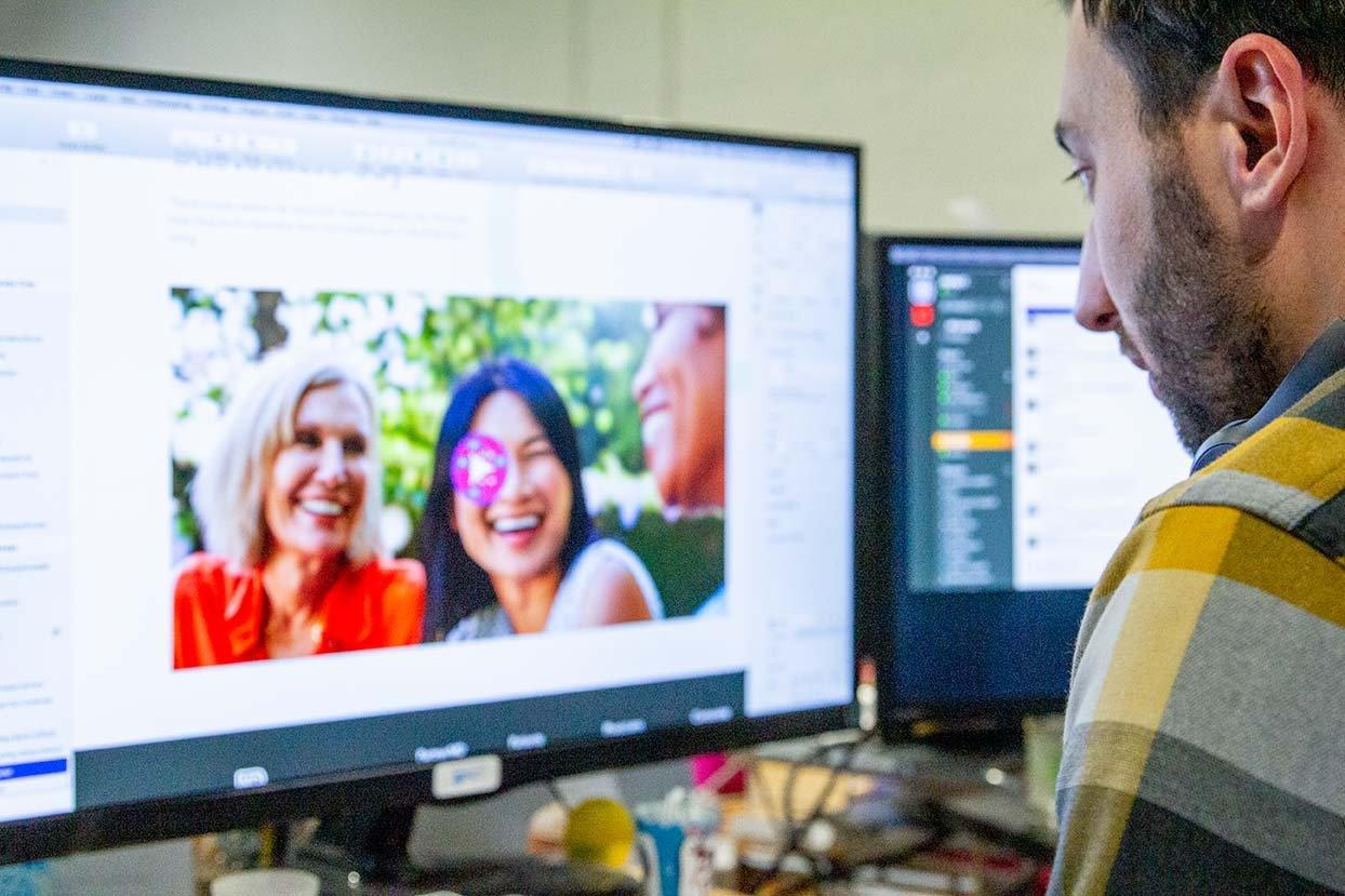 Designer Creating a Website - Website Design Strategy for HubSpot and Wordpress